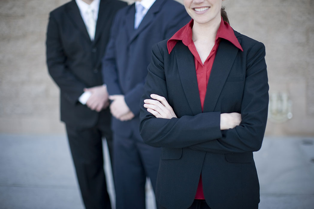 business people with arms crossed in front