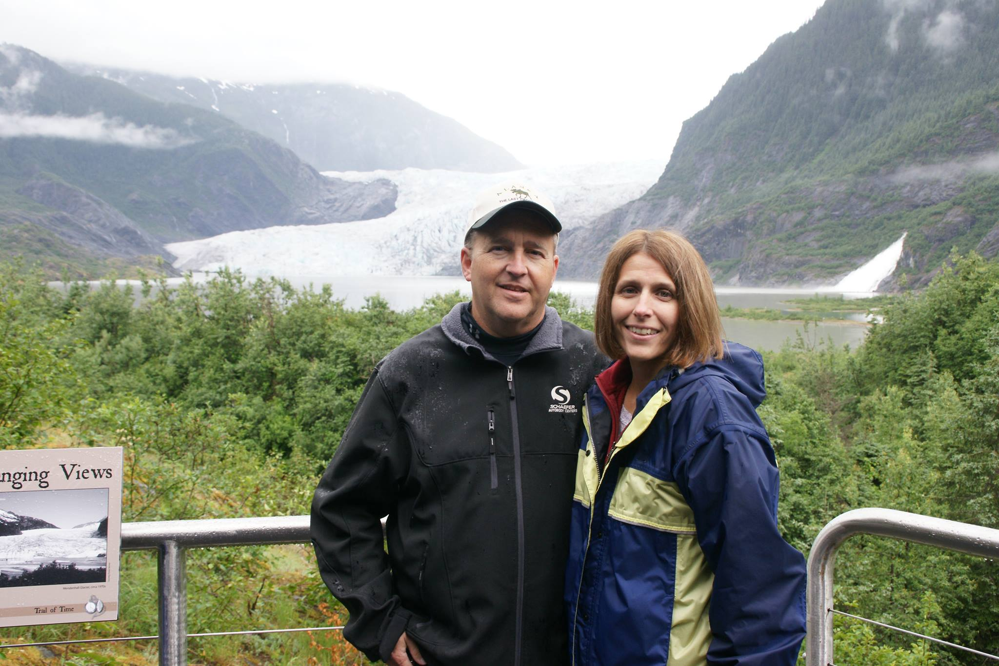 kevin and wife in front of scenic view smiling