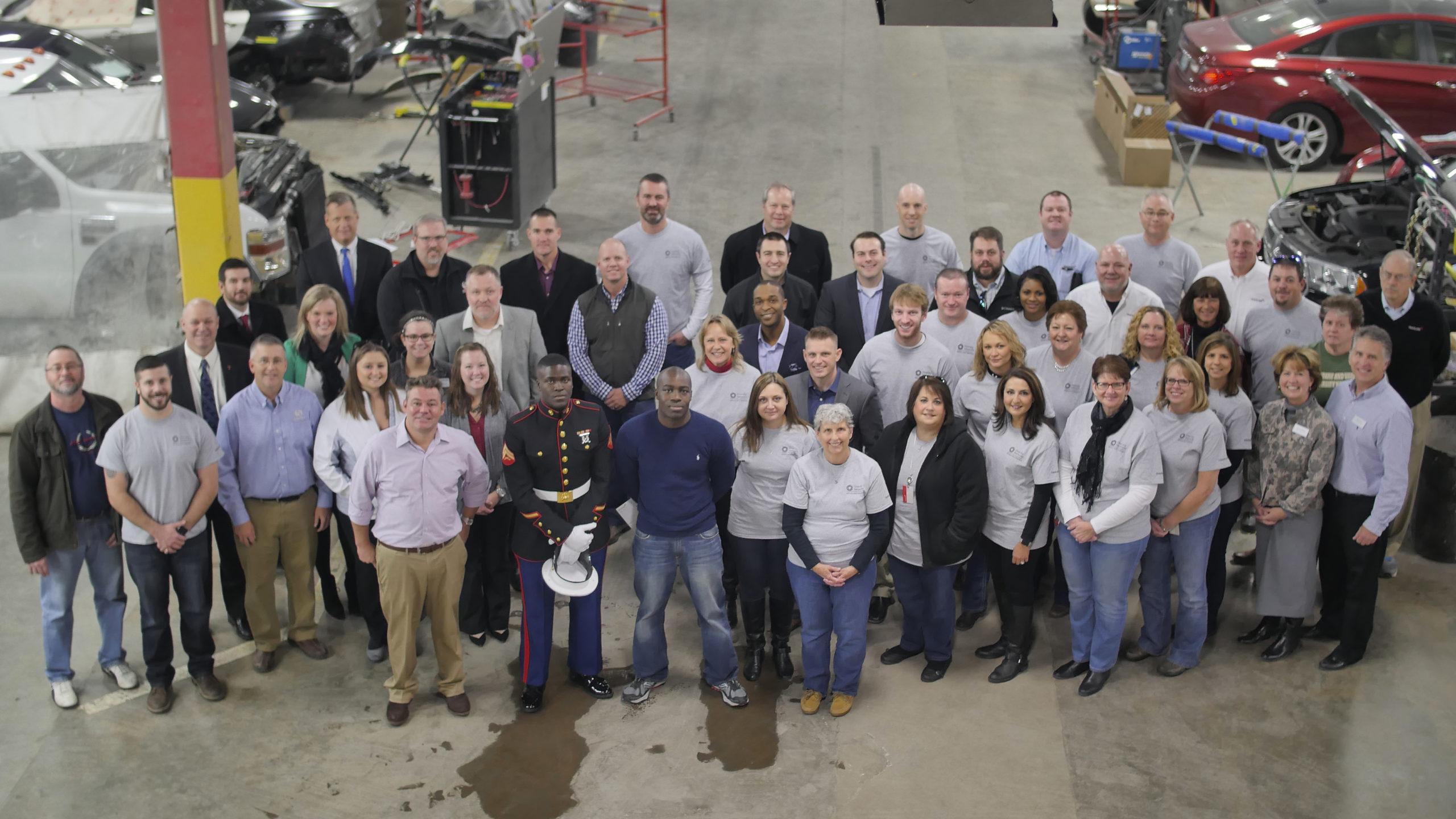 overhead group photo of people in repair shop