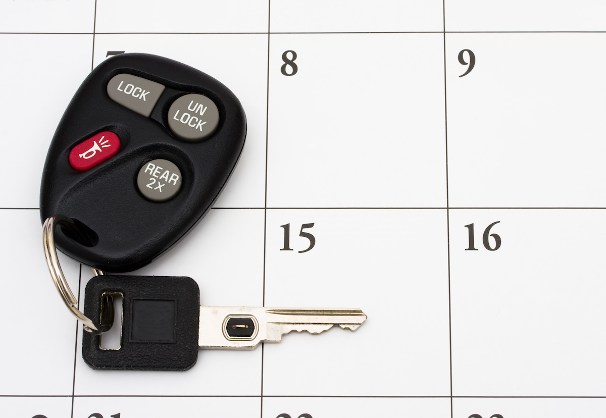 A set of car keys on a calendar