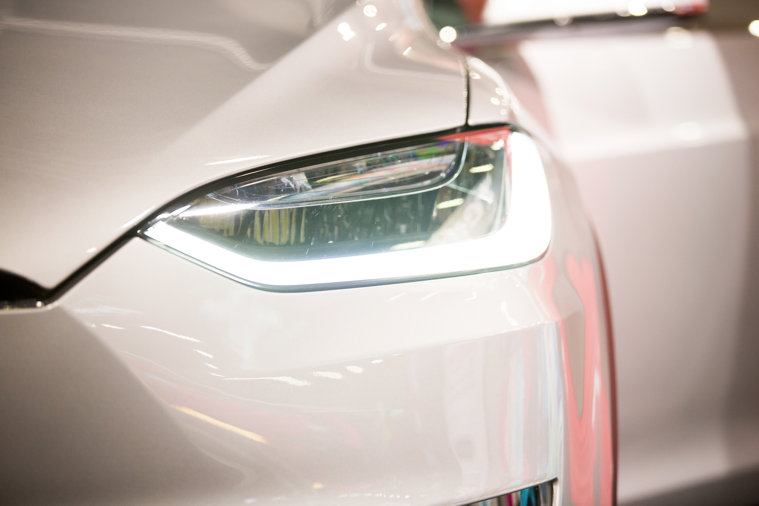 The body of a electric car. Hood, headlamp, front.