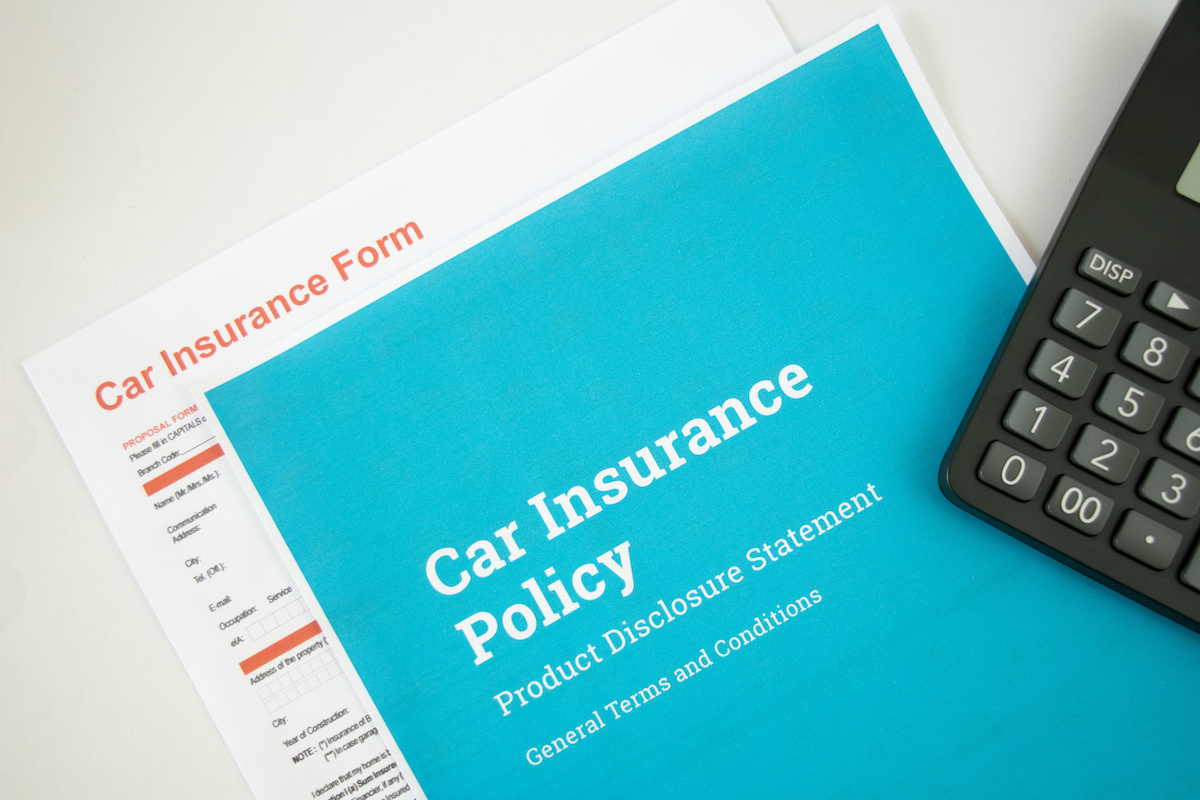 Top view of Car insurance concept with car insurense policy, form and calculator on a white background