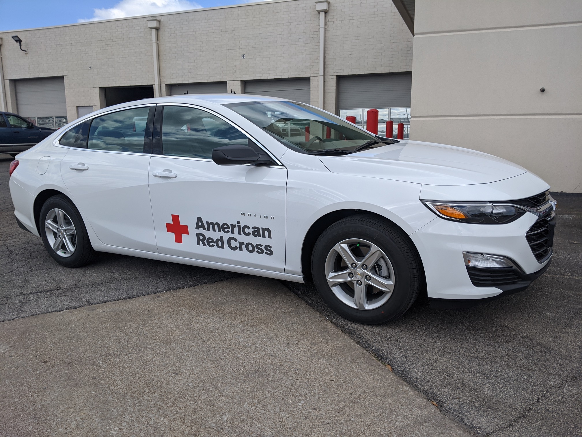 White car with American Red Cross logo on the side