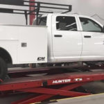 http://Fleet%20vehicle%20up%20on%20a%20scissor%20lift%20to%20be%20serviced.